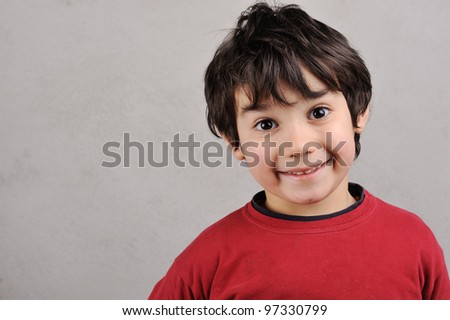 close up portrait of a kid smiling to the camera - stock photo