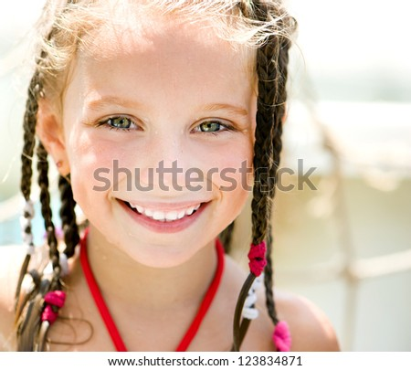 close-up portrait of a little girl aquapark. Summer holiday. - stock photo