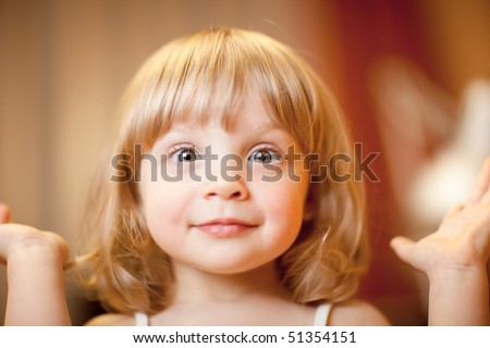 Close-up portrait of a little girl, shallow DOF, focus on eyes - stock photo
