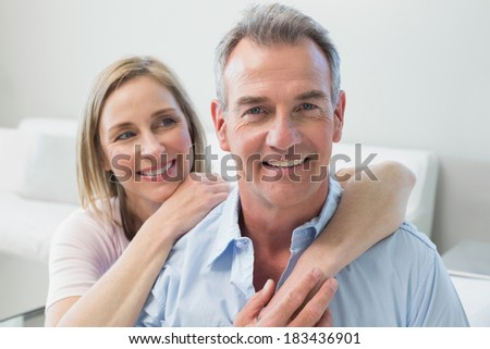 Close-up portrait of a loving couple in the living room at home - stock photo