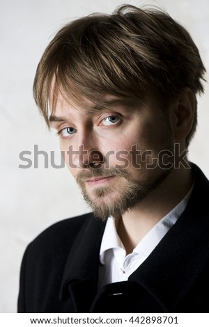 Close-up portrait of a macho man  - stock photo