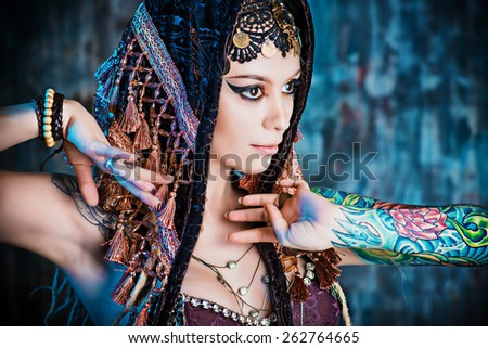 Close-up portrait of a magnificent traditional female dancer. Ethnic dance. Belly dancing. Tribal dancing. Make-up, cosmetics. - stock photo
