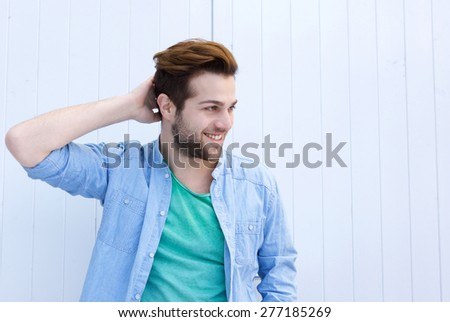 Close up portrait of a male fashion model posing with hand in hair - stock photo