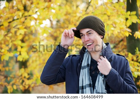 Close up portrait of a man smiling outdoors in warm clothing - stock photo