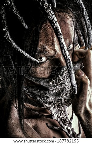 Close-up portrait of a mythical creature male. Alien creature. Horror. Halloween. Isolated over white. - stock photo