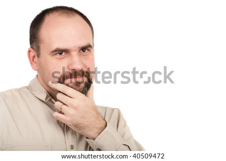 Close up portrait of a pensive or doubtful young businessman, studio shot - stock photo