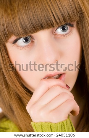 Close-up portrait of a pensive teen girl