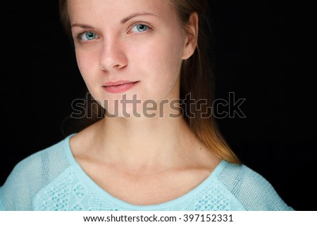 Close-up portrait of a pensive young woman. - stock photo