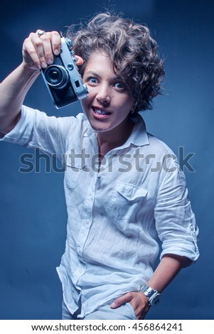 Close-up portrait of a photographer shooting pictures with the camera - stock photo