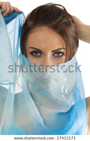 close up portrait of a pretty brunette with blue-sky headscarf playing to hide her face