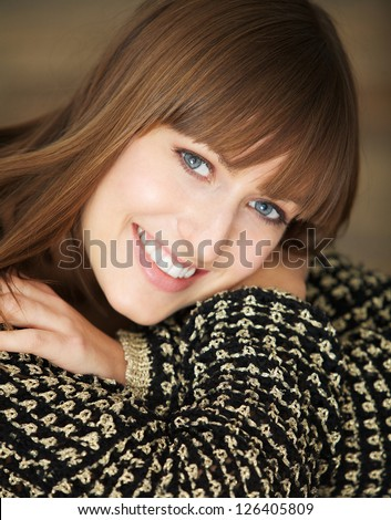 Close up portrait of a pretty girl smiling - stock photo