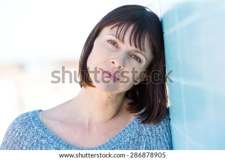 Close up portrait of a pretty older woman  - stock photo
