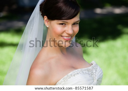 Close-up portrait of a pretty young bride smiling