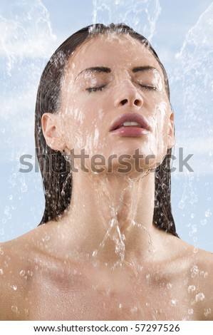 close up portrait of a pretty young woman getting some fresh water on her face falling down - stock photo