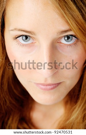 Close up portrait of a redhead caucasian woman looking up, with barely any make up