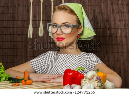 Close-up portrait of a rural woman cook with vegetable - stock photo