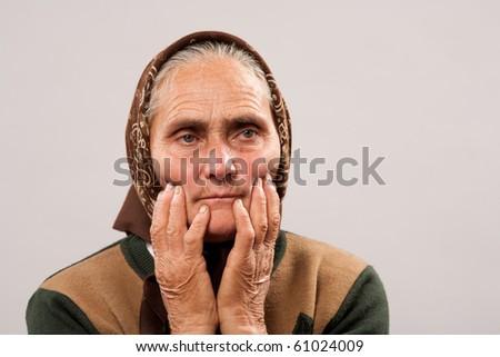 Close up portrait of a sad older woman - stock photo