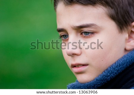 Close up portrait of a sad teenager - stock photo