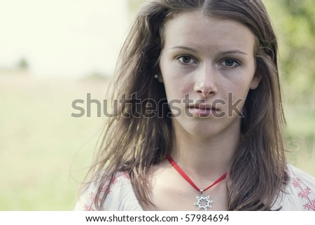 Close-up portrait of a sad young woman - stock photo