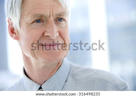 Close up portrait of a senior businessman looking away