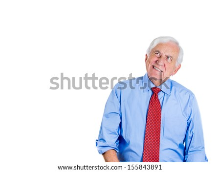 Close-up portrait of a senior executive, elderly man, grandfather, looking grumpy, unhappy, and very annoyed by something, isolated on a white background with copy space. Human emotions, expressions. - stock photo