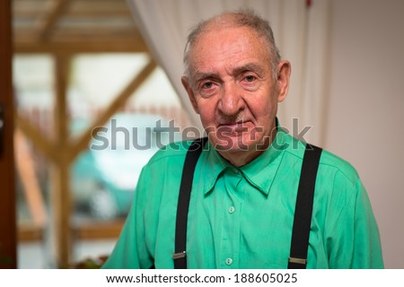 Close up portrait of a senior man looking directly at the camera  - stock photo