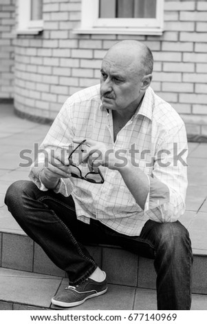Close-up portrait of a senior man thinking about something. A depressed and dejected man
