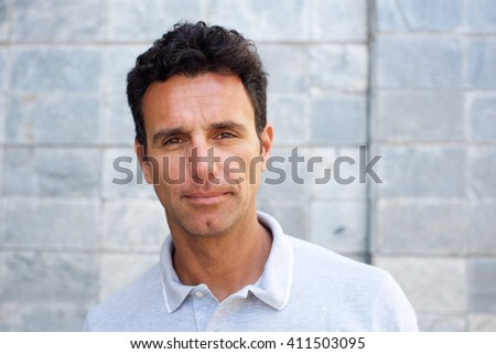 Close up portrait of a serious older man staring  - stock photo