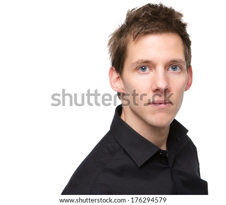 Close up portrait of a serious young man looking at camera on isolated white background