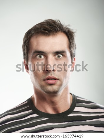Close-up portrait of a shocked man - stock photo