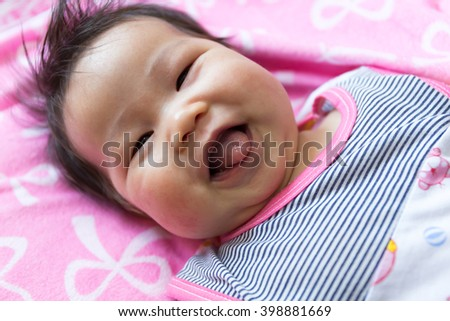 Close up Portrait of a sian cute Infant baby girl (baby are three months) - stock photo