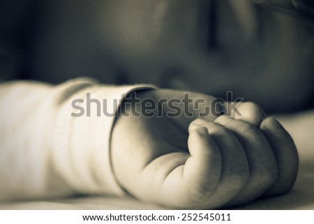 Close-up portrait of a sleeping baby - stock photo