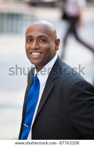 Close-up portrait of a smiling African American business man - stock photo