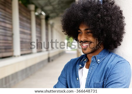 Close up portrait of a smiling african american man with afro