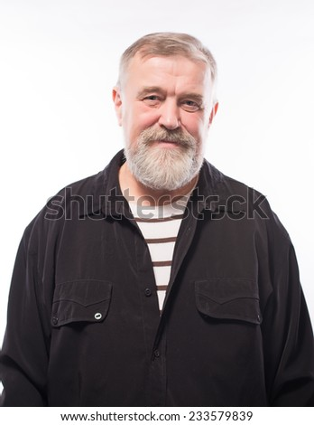 Close up portrait of a smiling attractive senior man looking directly at the camera with copyspace - stock photo