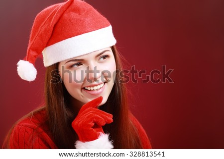 close up portrait of a smiling beautiful happy girl in christmas santa hat. beauty woman. thinking over red background happy new year 2016. - stock photo