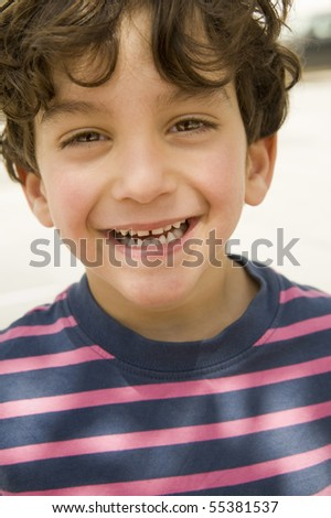 close up portrait of a smiling kid - stock photo