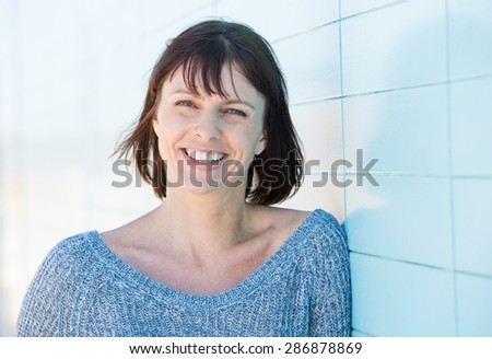 Close up portrait of a smiling mature woman  - stock photo
