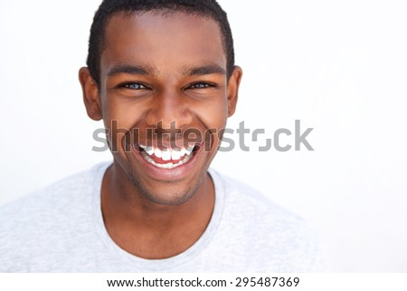Close up portrait of a smiling teenage african american guy - stock photo