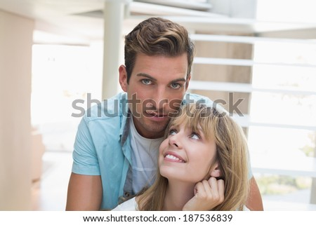 Close-up portrait of a smiling young couple at home