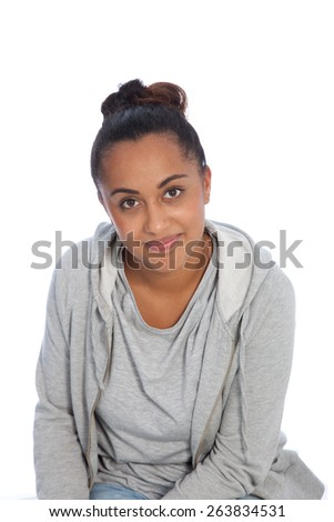 Close up Portrait of a Smiling Young Indian Woman Wearing Casual Gray Jacket Looking at Camera. Isolated on White Background.