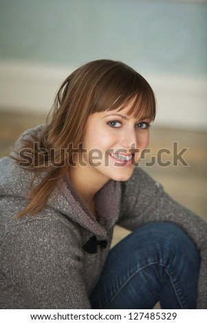Close up portrait of a smiling young woman - stock photo