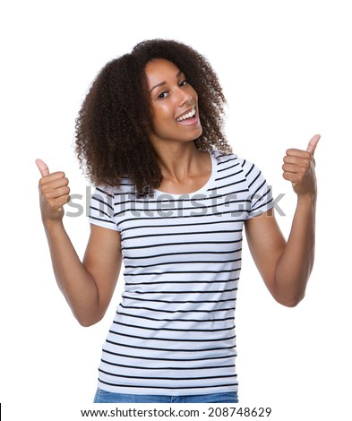 Close up portrait of a smiling young woman with thumbs up - stock photo