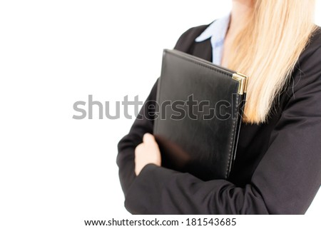 Close-up portrait of a successful business woman standing and holding a folder, isolated against white. Copy space. - stock photo