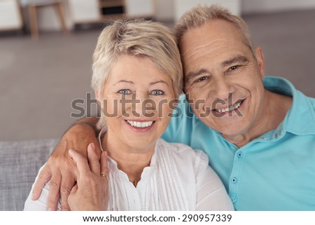 Close up Portrait of a Sweet Cheerful Middle Aged Husband and Wife Smiling at the Camera - stock photo