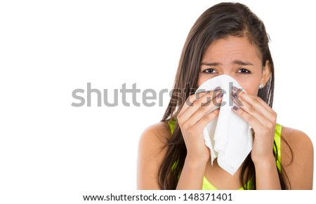 Close-up portrait of a teen woman with allergy or cold, isolated on white background with copy space  - stock photo