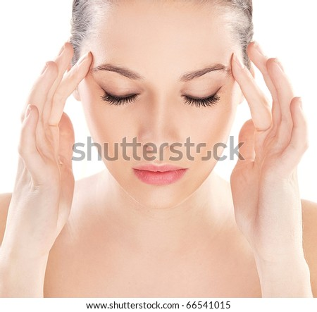 Close-up portrait of a thinking young beauty - stock photo