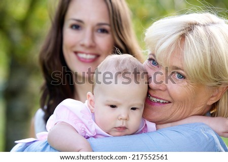 Close up portrait of a three female generations - stock photo
