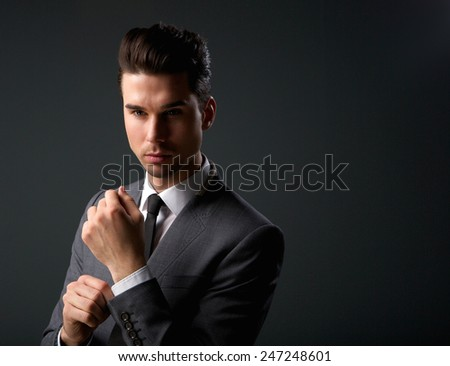 Close up portrait of a trendy young man in modern business suit - stock photo