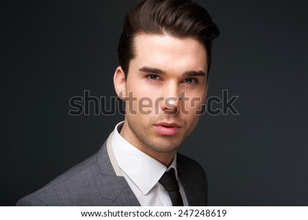 Close up portrait of a trendy young man in suit and tie